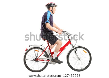 A senior bicyclist ridng a bicycle isolated on white background - stock photo