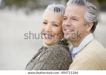 A senior couple on a beach - stock photo