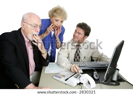 A senior couple shocked by something their accountant is telling them about their taxes. - stock photo