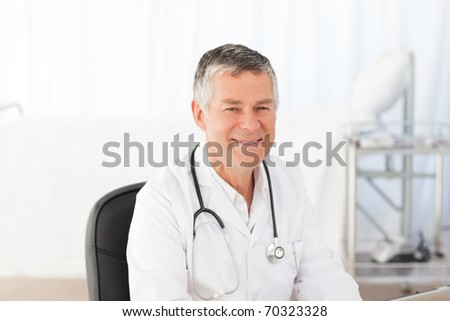 A senior doctor in his office - stock photo