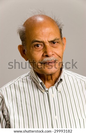 A senior Indian man against a white background - stock photo