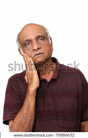 A senior Indian man looking very sad - stock photo