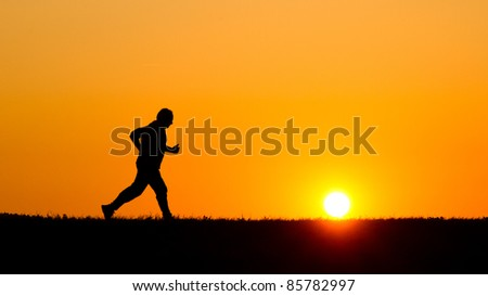 A senior jogging in the evening - stock photo