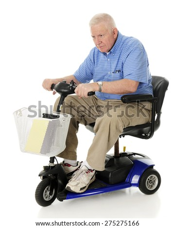 A senior man aggressively driving his scooter. Motion blur on wheels.  On a white background. - stock photo