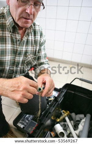 A senior man with a toolbox - stock photo