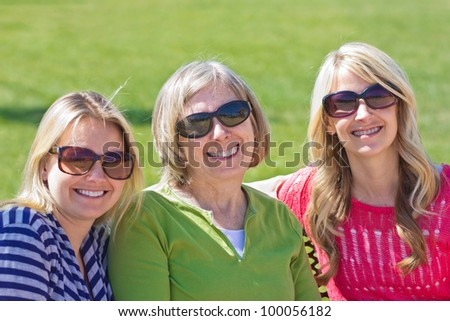 A senior mother with her adult daughters - stock photo