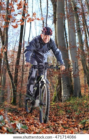 A Senior on Mountain bike in forest