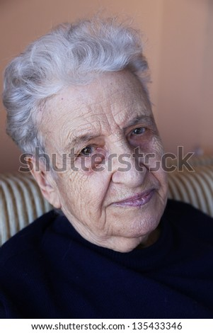 a senior person looking to camera