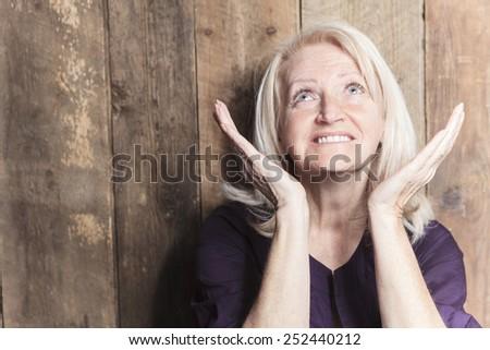 A senior woman pray with a - stock photo