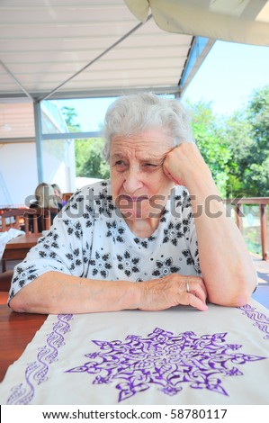 a senior woman thinking - stock photo