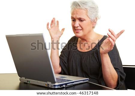 A senior woman working on a laptop - stock photo