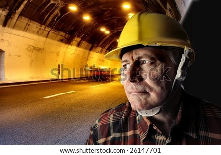 a senior worker in a tunnel - stock photo