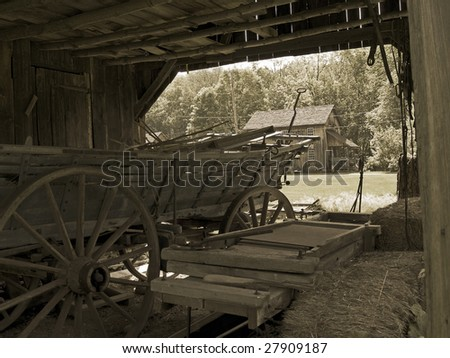 A sepia toned photo of an old farm wagon in the historic Millbrook Village, located in North Western, New Jersey. - stock photo