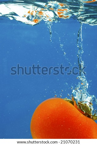 A series, fruit in water on a dark blue background - stock photo