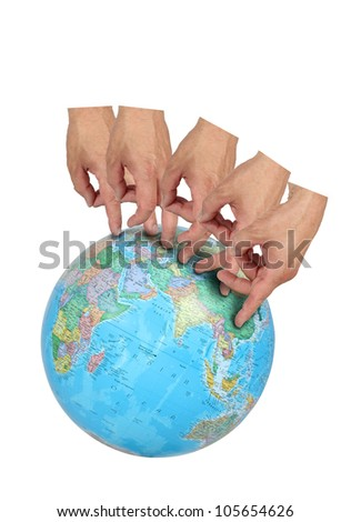 A series of finger steps on a globe imply world travel on white - stock photo