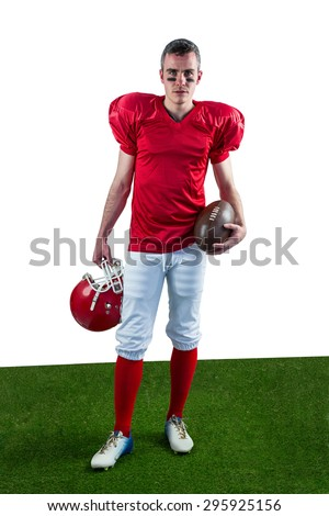 A serious american football player taking his helmet on her handlooking at camera with white background - stock photo