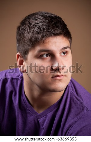 A serious young man that is thinking about something very deeply. - stock photo