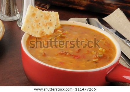 A serving crock of chicken and sausage gumbo - stock photo