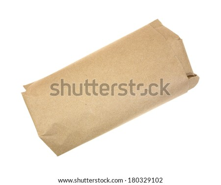 A serving of butchers meat wrapped in brown paper. - stock photo