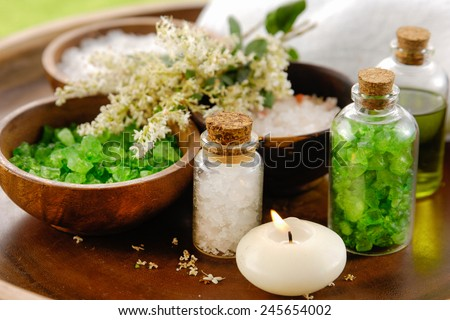 A set of Bath salt on the wooden table. Asian spa massage. - stock photo