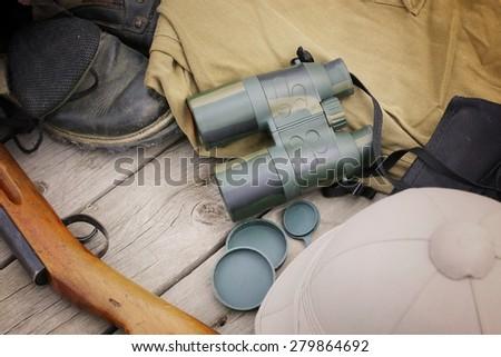 a set of binoculars hunter shotgun skin - stock photo