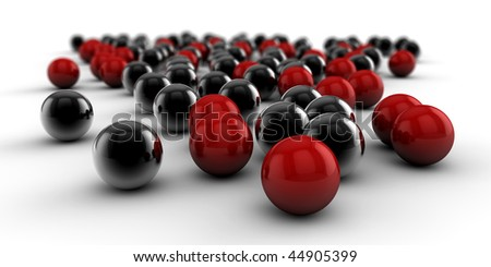 A set of black and red balls as concept for teamwork, isolated on white background - stock photo