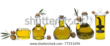 A set of bottles of olive oil. - stock photo