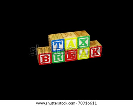 "A set of children's blocks spells out the phrase ""tax break"". - stock photo"