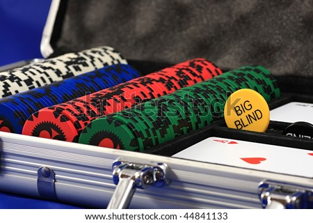 A set of chips and cards for the sport of poker. - stock photo