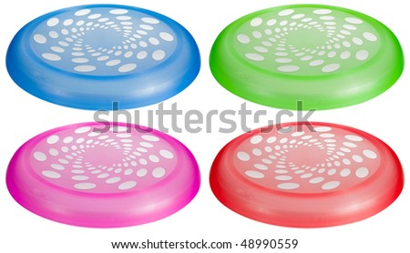 A set of colorful flying toy discs isolated on white. - stock photo