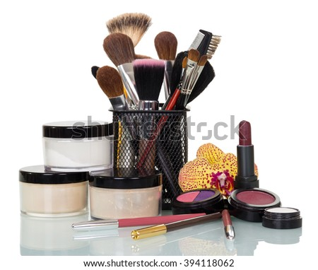 A set of cosmetics and professional brushes for makeup isolated on white background. - stock photo