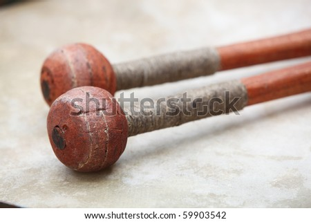 A set of drum sticks on drum - stock photo