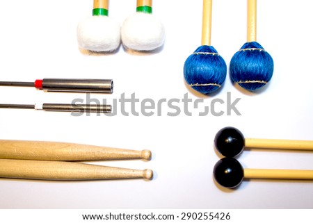 A set of drum sticks percussion mallets  on a white background - stock photo