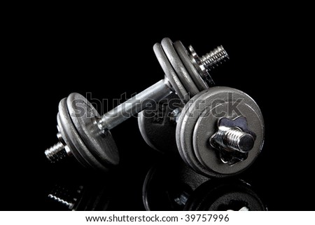 A set of dumbbells on a black background