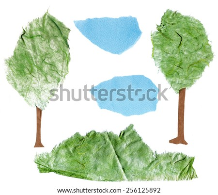 A set of ecologically themed isolated design elements cut out of paper: trees, clouds and grass - stock photo