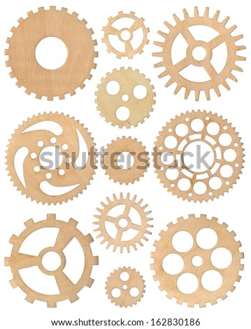 A set of eleven wooden gear wheels  - stock photo