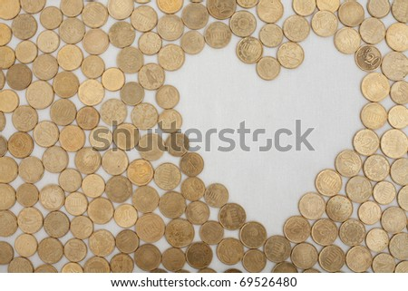 a set of eurocent coins leaving a heart shaped field empty - stock photo