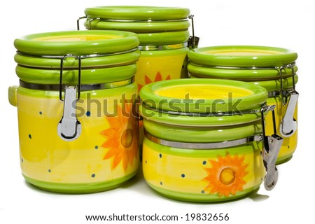 A set of four handmade, colorful ceramic storage for loose products, isolated on white background - stock photo