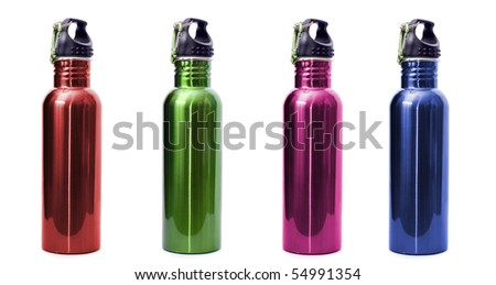 A set of four safe, reusable stainless steel water bottles isolated on white background in red, green, pink, and blue. - stock photo