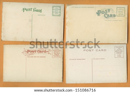 A set of 4 full size blank old postcards that are one hundred plus, years old. - stock photo