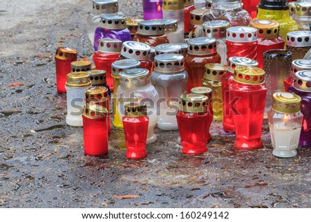 A set of grave candles on a cemetery named Mirogoj in Zagreb, Croatia - stock photo