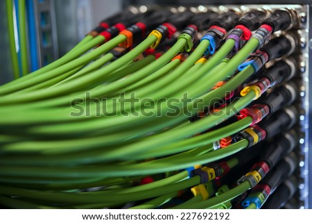 A set of green network cables to connect the terminal to the server - stock photo