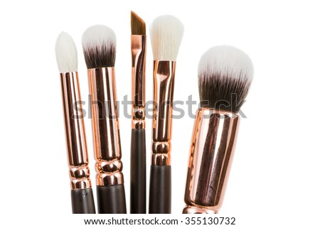 A set of isolated make-up brushes