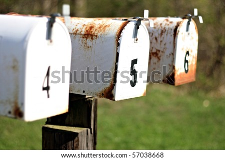 A set of mailboxes with the numbers four, five, and six on them - stock photo