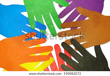 A set of multicolored paper handprints on a white background