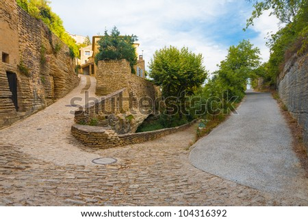 A set of narrow streets at sharp hairpin turn angles in the picturesque medievel village of Gordes, Provence, France - stock photo