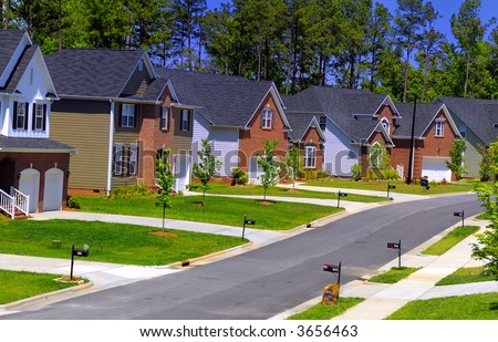 A set of newly built colonial houses in a subdivision - stock photo
