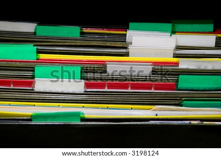 A set of organized file folders in an office - stock photo