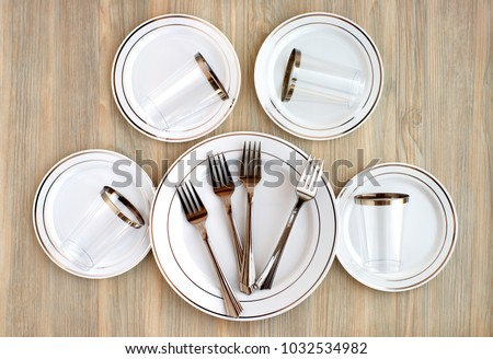 A set of plastic dishes. Disposable plastic dishes for a picnic. View from above & Set Plastic Dishes Disposable Plastic Dishes Stock Photo (Royalty ...