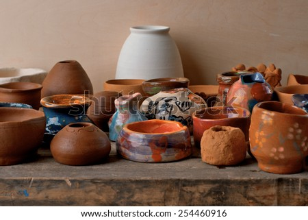 A set of pottery in wooden desk surface - stock photo